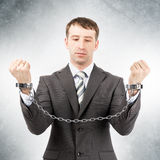 Businessman in cuffs Royalty Free Stock Photo