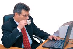 Businessman with a cup of coffee Royalty Free Stock Photo