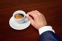 Businessman and cup of coffee Stock Photos
