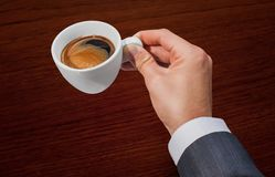 Businessman and cup of coffee Stock Images