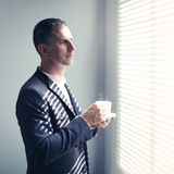Businessman with cup of coffee Royalty Free Stock Image