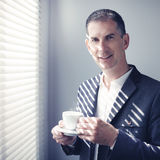 Businessman with cup of coffee Royalty Free Stock Photography