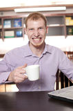 Businessman with cup of hot coffee Stock Photography