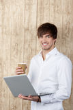 Businessman With Cup And Laptop Stock Images