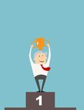 Businessman with cup on a winners podium Royalty Free Stock Photos