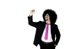 Businessman with curly hair writes on whiteboard Royalty Free Stock Photography