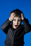 Businessman, cute little boy portrait over blue chroma backgroun Royalty Free Stock Photos