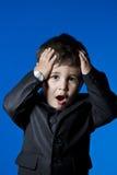 Businessman, cute little boy portrait over blue chroma backgroun. D Royalty Free Stock Photos