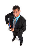 Businessman cutting credit card Royalty Free Stock Image