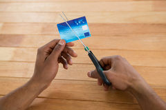 Businessman cutting credit card with scissors. Hand of businessman cutting credit card with scissors stock photos