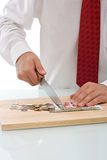 Businessman cutting the currency Royalty Free Stock Photography
