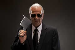 Businessman with cutting knife Stock Photo