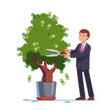 Businessman cutting money off investment tree Royalty Free Stock Photo