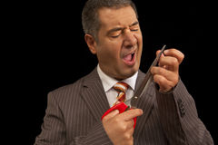 Businessman cutting nails scisors hurt himself Stock Photos
