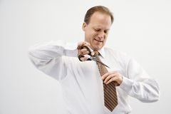 Businessman cutting necktie Royalty Free Stock Photography