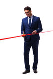 The businessman cutting red ribbon isolated on white Royalty Free Stock Photography