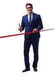 The businessman cutting red ribbon isolated on white Royalty Free Stock Photos