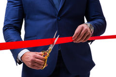 The businessman cutting red ribbon isolated on white Stock Photography