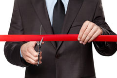 A businessman cutting a satin ribbon Royalty Free Stock Photography