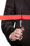 A businessman cutting a scarlet satin ribbon Stock Image