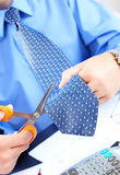 Businessman cutting the tie Stock Images
