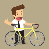 Businessman cycling for health and energy saving Stock Photography