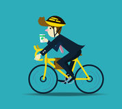 Businessman cycling to work. Royalty Free Stock Photo