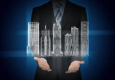 Businessman with 3d model of city Stock Photo