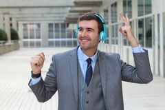 Businessman dancing while listening to music in office space Stock Image