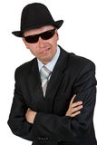 Businessman in dark glasses and a hat Stock Images