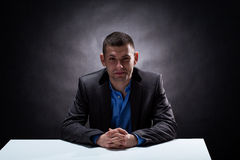 Businessman in a dark room Royalty Free Stock Photography