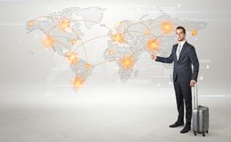 Businessman going to business trip with map. Businessman in dark suit hitchhike to business trip in a front of a map with destination Stock Photos