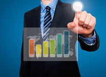 Businessman in dark suit pushing button, visual screen Growth gr Royalty Free Stock Images