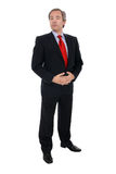 Businessman in dark suit and red tie Royalty Free Stock Photography