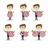 Businessman with a dart board with a direct hit on target . Set of Businessman in different poses with a dart board with a direct hit on target . Full length Stock Photo