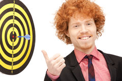 Businessman with dart and target Stock Photography