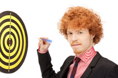 Businessman with dart and target Stock Photo