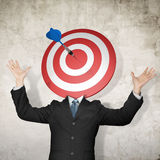 Businessman with dartboard on head Royalty Free Stock Image