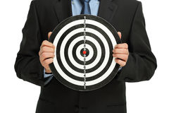 Businessman with dartboard Stock Image
