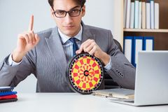 The businessman with dartboard sitting at the office royalty free stock images
