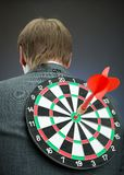Businessman with darts board on his back Stock Image