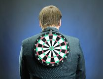 Businessman with darts board on his back Stock Photography