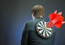 Businessman with darts board on his back Stock Images