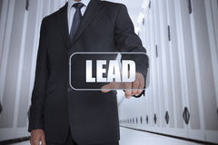 Businessman in a data center selecting label with lead Royalty Free Stock Image