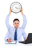 Businessman dateline concept. Dateline concept of man holding clock while working Royalty Free Stock Photography