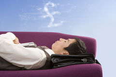 Businessman daydreaming about money Royalty Free Stock Images