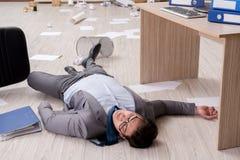 The businessman dead on the office floor Stock Photos