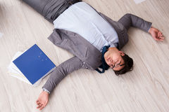 The businessman dead on the office floor Royalty Free Stock Images