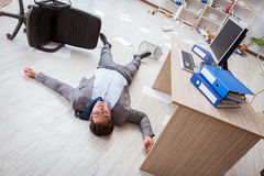The businessman dead on the office floor Royalty Free Stock Image