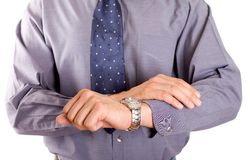 Businessman and deadline. Businessman in hurry looking at watch royalty free stock photo